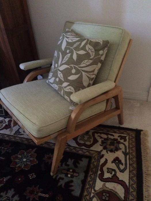 Mid-Century Modern chair with pale green upholstery