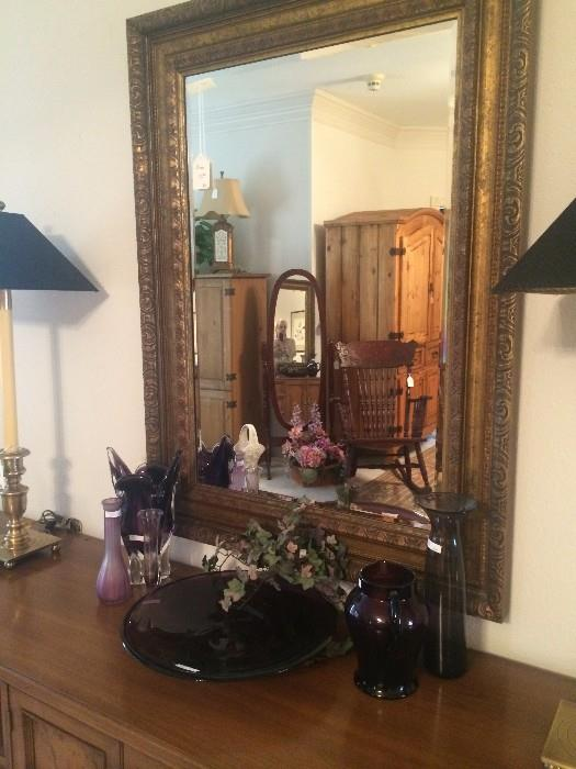 Triple dresser; decorative glassware in purple; matching lamps with black shades;  framed mirror; antique rocker; 2 pine armoires; oval floor mirror