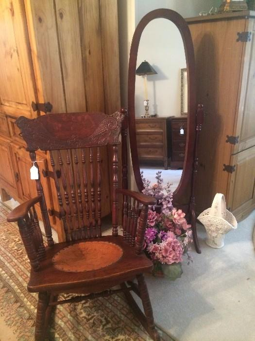 Antique rocker and oval floor mirror