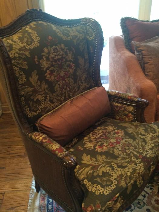 One  of two identical formal arm chairs