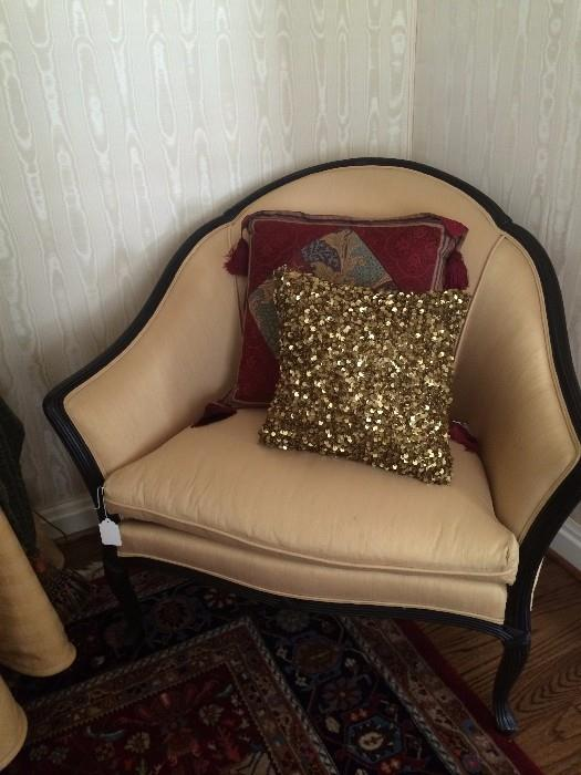 Luscious gold chair with decorative pillows