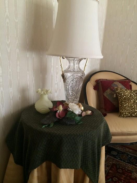 Custom cloths over small round table; one of many lamps