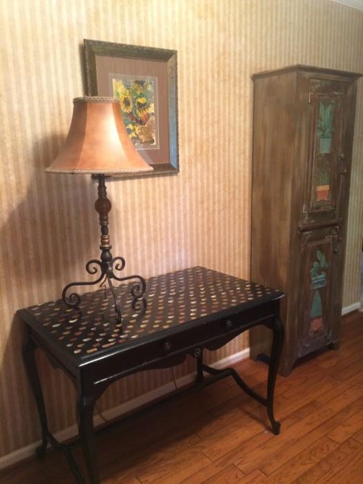 painted table and precious painted cabinet in the background