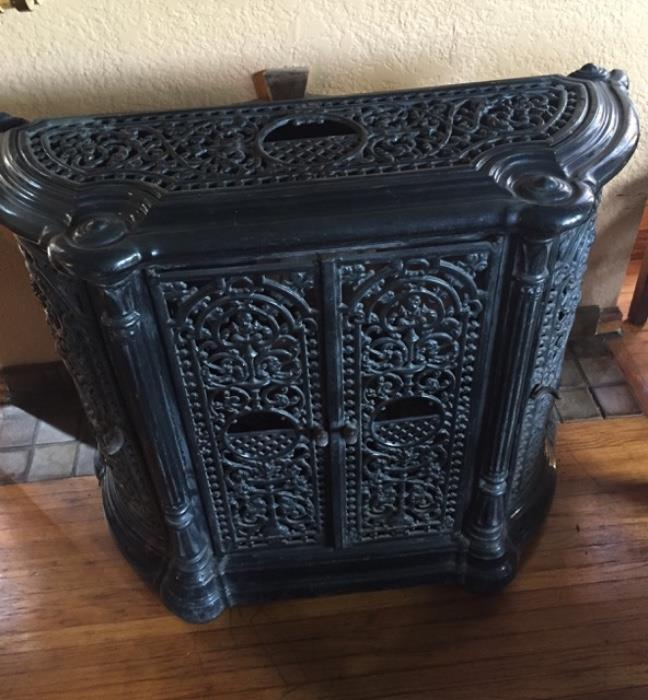 This is an antique enameled French stove.  It opens in front and on the sides.  Can be used as a bar, console and stereo cabinet.  Casts beautiful shadows on the wall and ceiling when candles are put inside.