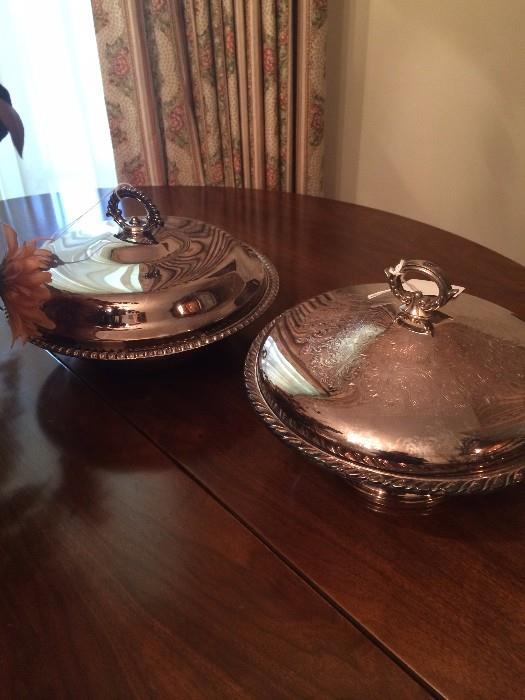 Two of several silver plate serving pieces