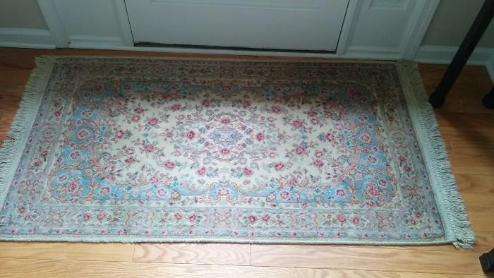 Hand made, 100% wool Persian Kirman area rug. There are more rugs, much prettier than this thing at the front door.                                                                                            I didn't want to place a Serapi or Ferrahan Sarouk by the front door, just so you could wipe your feet on it.