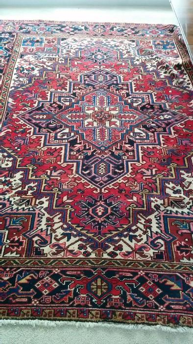 "A lovely hand woven, 100% wool Persian Heriz, hiding under the invisible dining room table perched atop the rug; measures 7'5"" x 9'6"""