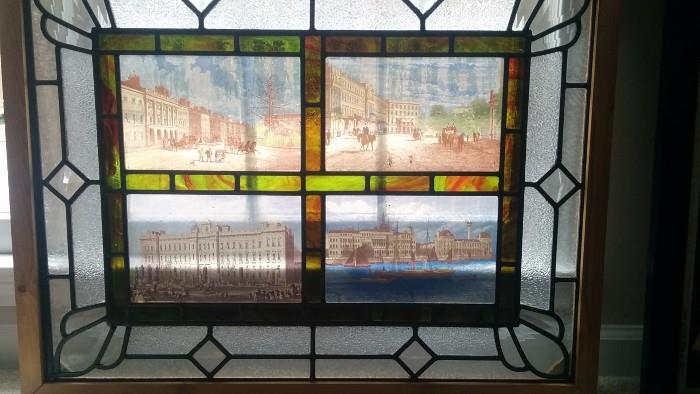 "Wonderful antique stained glass panel, one of a pair, featuring European cities and 3-D colored glass ""diamonds"""