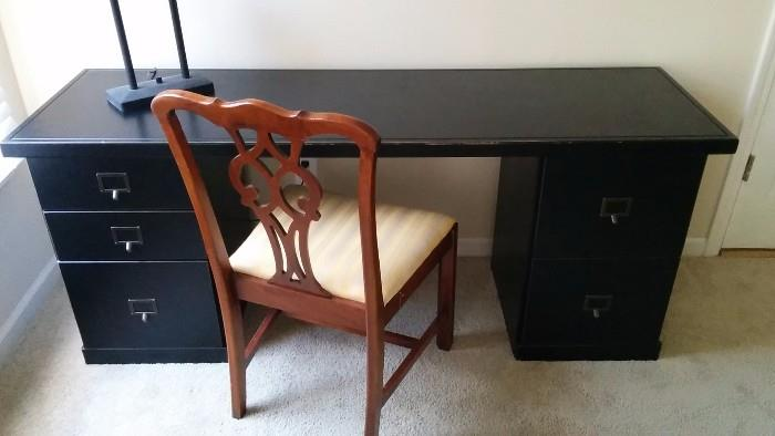 Black wooden desk from Ballard Designs, mahogany side chair, manufactured by Statesville & Ross, Statesville, NC.