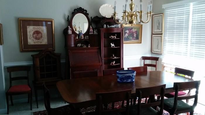 Here's a better pic of the mahogany table. It has three leaves and 12 chairs. There's also the Victorian desk/chest/display cabinet thing. It's quite nice, once I put my magic spit on it.