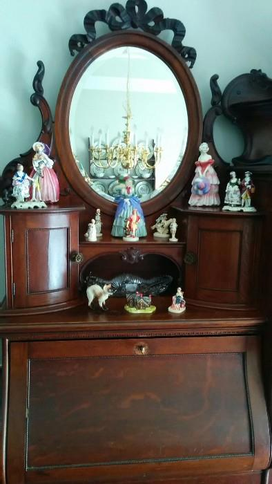 "Roayl Doulton figurines: ""June"", ""Veronica"" and ""A Victorian Lady"".                                                                                Also, a collection of ""Sebastian Miniatures"", designed by Prescott W. Bastom, of Marblehead, MA.                            Perhaps he should have his head examined..."