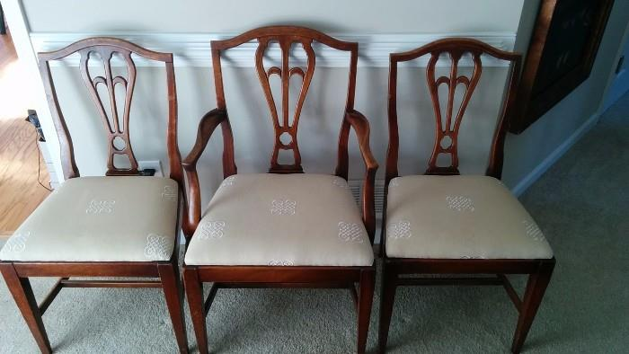 Rogue mahogany dining chairs, from a broken home. This poor Mother chair is trying to raise two children, while working three jobs.                                                     She can barely afford acrylic nails and hair extensions. Please help, if you can find it in your heart to do so.