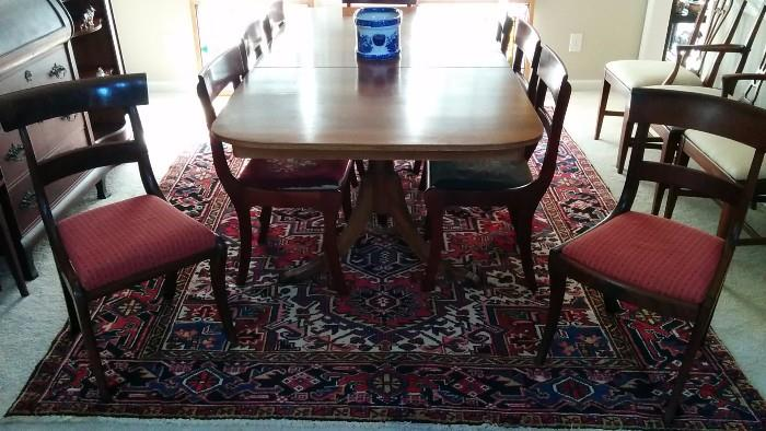 Nice shot of the mahogany dining table, Persian Heriz rug and two of the side chairs.