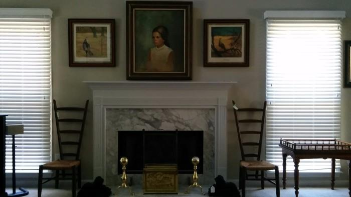 Lovely oil portrait of the owner's wife, signed by Virginia Walters, flanked by a fetching pair of Wild Turkey prints, by Ken Davies - 'tis the season, sort of.        The marble fireplace is flanked by a vintage pair of wooden/rattan vintner's chairs, from Italy.