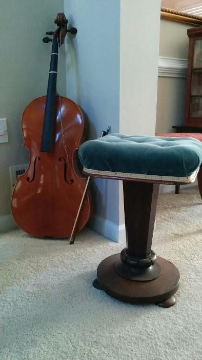Everyone needs a cello in their living room, if nothing else just to look classy and educated. There are no strings on this one, so your guess is as good as mine as to how classy this one is. Antique piano stool from a French Erard grand piano. What? It IS a good pairing!