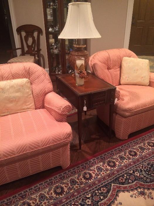 Matching peach-colored chairs; one of two matching side tables and lamps