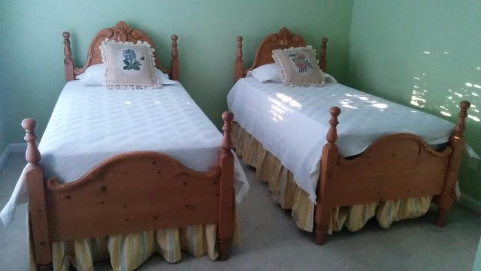 The CUTEST pair of hand-carved heart pine twin beds you'll see! Custom made dust ruffles and hand embroidered/tasseled pillows.                                                   If your marriage has degraded to the point that you sleep in separate beds, take the tassels off the pillows and use them imaginatively to put that special spark back into the bedroom!
