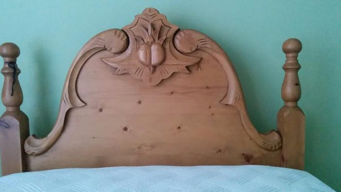 Close-up shot of one of the heart pine twin bed headboards