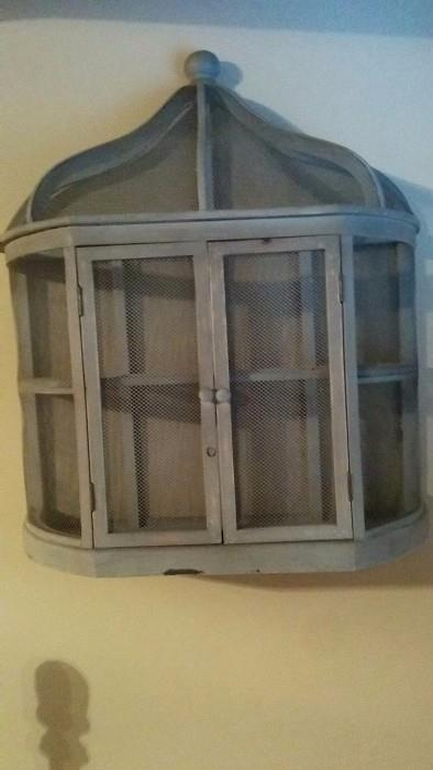 Wall-mounted, French grey birdcage. That's NOT Tweety lurking in the bottom left hand corner.