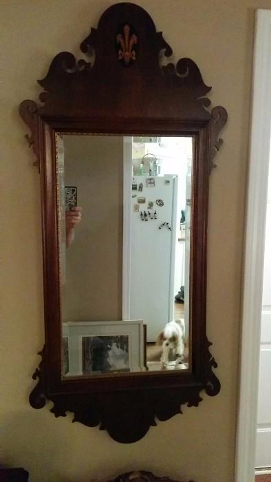 Nice repro mirror with all the trimmings - inlaid wood fleur de lis at top, lot's o' curlicues top and bottom, with a pretty beveled mirror reflecting the cutest Cavalier King Charles Spaniel you'll ever see!