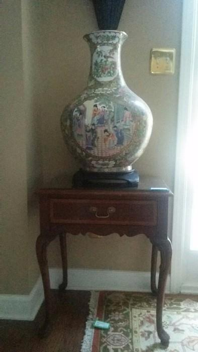 LARGE porcelain Asian Vase, on wooden stand; the other of the pair of glass-topped mahogany side tables, by Hickory Furniture Co.