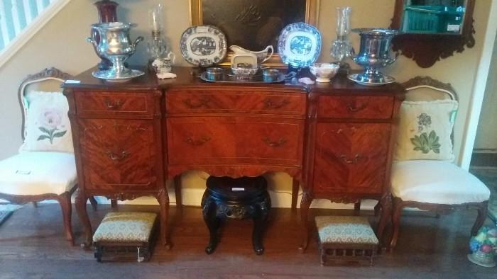Vintage French Provincial buffet/sideboard, antique Asian carved wooden stool, with original paper export label, pair of Victorian footstools, pair of open-backed French side chairs, antique English transfer ware china.