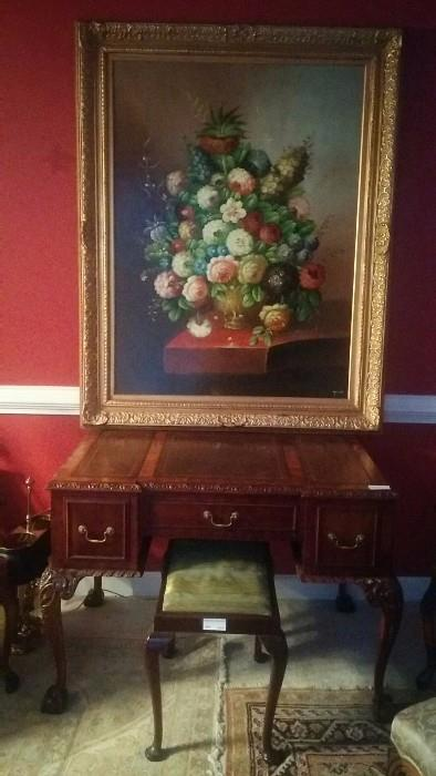Beautiful original, artist signed oil on board floral still life. Antique French carved mahogany ball/claw foot desk, w/tooled leather inserts.