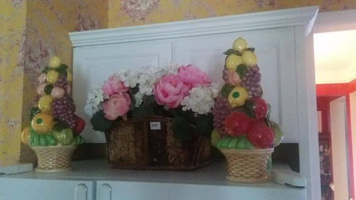 YUCK! Someone's sweet aunt, or a 12-step recovery activities class program produced this pair of ceramic kitchen atrocities. Obligatory , but nice, basket of silk peonies atop the fridge.