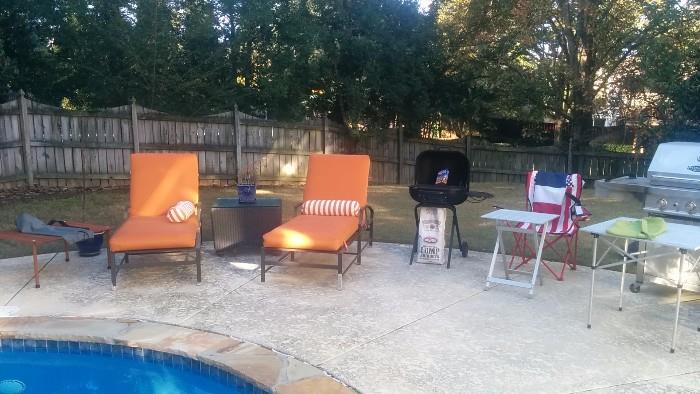Aww! Summer's last hurrah - a nice gas grill, chaise lounges, barbeque grill, red/white/blue folding chairs.