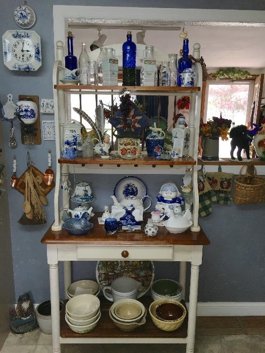 Country cottage bakers rack with kitchen collectibles
