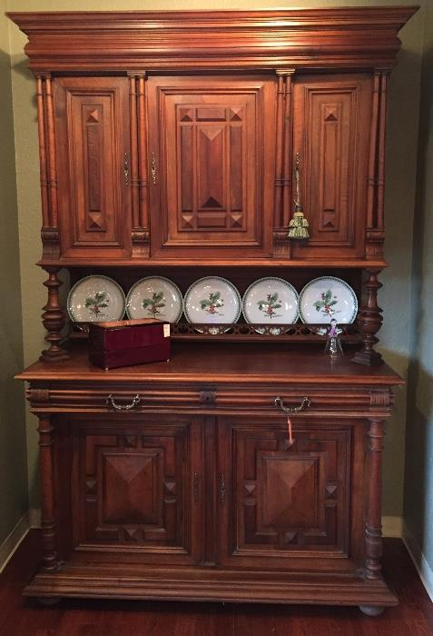 Antique French cupboard and Christmas plates.