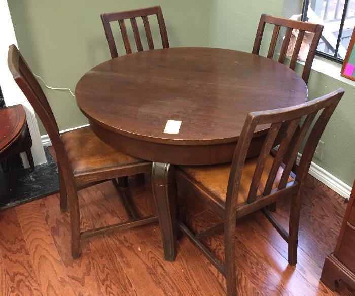 Antique German oak expandable table and four oak chairs.