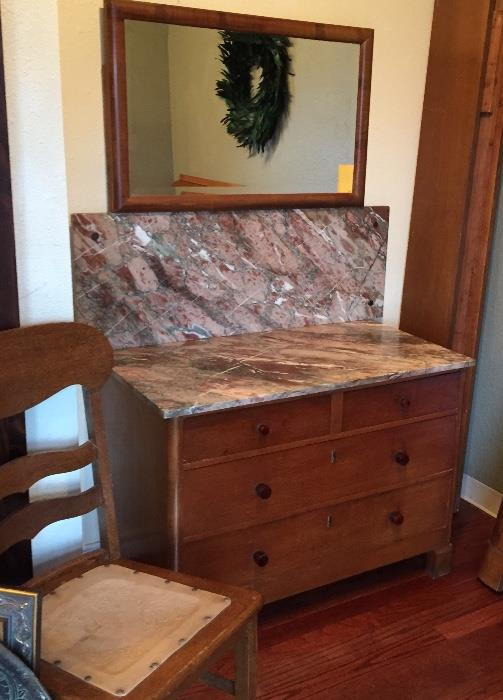 Mid-century marble topped dresser with mirror and oak chair with leather embossed seat.