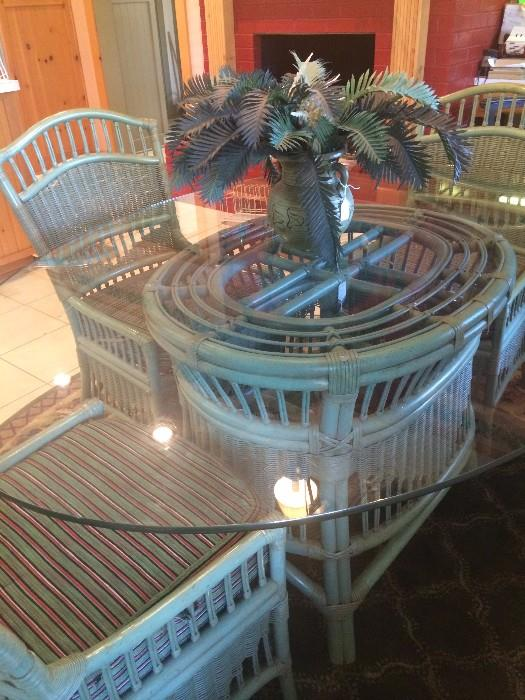 Glass top rattan table has 6 chairs