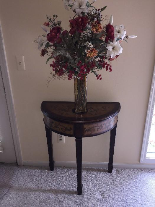 SMALL HALF MOON TABLE WITH BEAUTIFUL FAUX FLOWER ARRANGEMENT