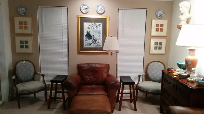 Ital Leather armchair & matching ottoman, pair of vintage French upholstered armchairs, set/4 framed French marbleized papers, nicely framed/matted French poster, silver-plated floor lamp, pair of Asian Sex Stools, overseen by a bust of Caligula - how touching...