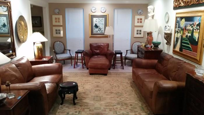 Wonderful living room, with loads of leather seating, hand woven 100% wool rug, GREAT art, smalls, etc.