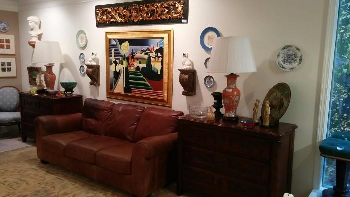 VERY dark pic - I'll retake tomorrow, BUT you're seeing a leather sofa, by ItalDesign, pair of wonderful French 3-drawer chests, pair of cinnabar porcelain Asian lamps, antique carved wood door transom, large contemporary original oil on canvas, gilded wall sconces, Staffordshire pugs, etc.