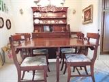 """Antique hard wood dining room set with 4 armless chairs, 2 captains chairs and china hutch. Table is 46"""" wide. Folded down it is 28"""". It has 2 - 24"""" flip-up sides and 2 - 10.5"""" leaves, allowing it to expand to 97"""" long. Hutch is 54"""" wide x 72"""" tall. Plenty of drawer and cupboard space for linens and silverware. Table & 6 chairs $350. Hutch $200"""