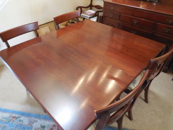 """Antique mahogany dining room set with 4 armless chairs, 2 captains chairs.Table is 46"""" wide. Folded down it is 28"""". It has 2 - 24"""" flip-up sides and 2 - 10.5"""" leaves, allowing it to expand to 97"""" long.  $350"""