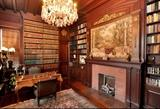 Library - walls of law books, French style writing desk with ormolu, pair of bronze torcheres with figures of ladies, scenic tapestry