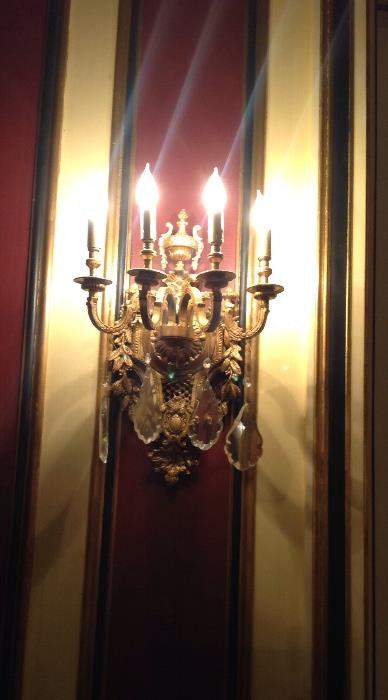 Two pairs of bronze sconces with crystal drops