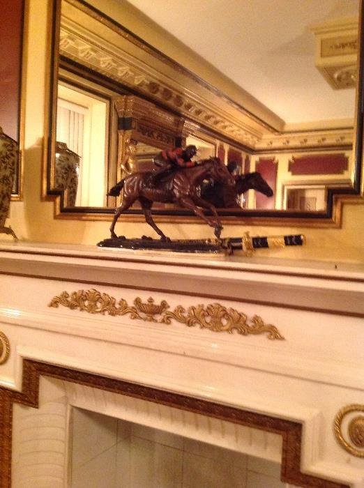 Patinated bronze jockey and horse statue