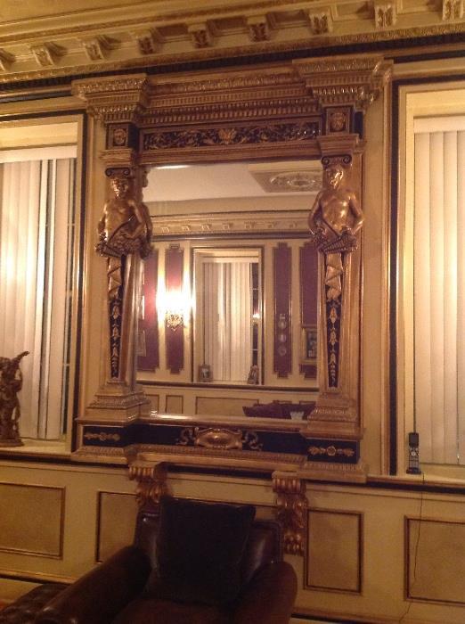 Monumental gilt and ebonized mirror with mythological figures