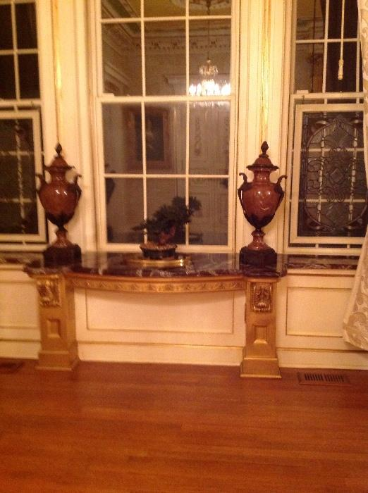 Pair of French style rouge marble and ormolu urns