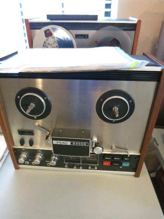 TEAC 2300S Reel To Reel, Tape and Heads have been cleaned.  Needs pinch roller serviced.