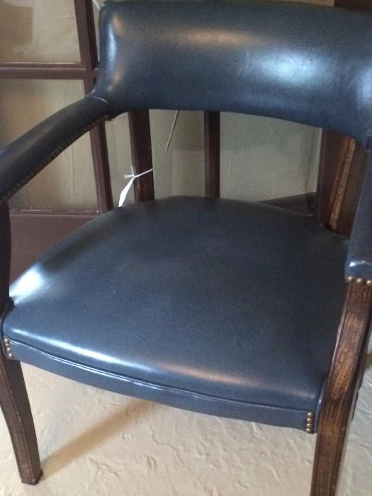 One of two blue arm chairs
