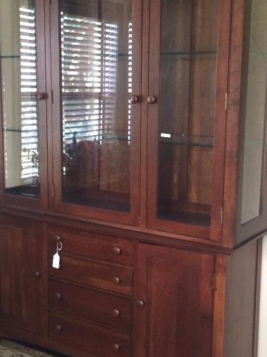 China cabinet has an extra long matching dining table