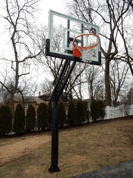Pro Dunk Gold Basketball. In-ground regulation size with glass backboard. Easy crank adjustment. New 4 J-Bolt Pier Kit is available online to install in a new location.