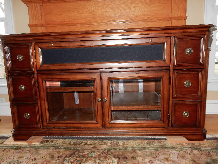 Stereo Cabinet with room for center speaker or sound bar. Also comes with wood fronts to replace glass if that is your desire.